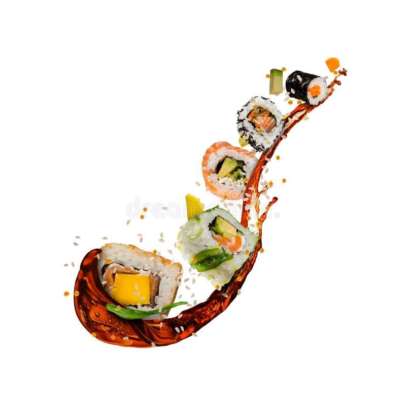 Het vliegen sushistukken op witte achtergrond royalty-vrije stock foto's