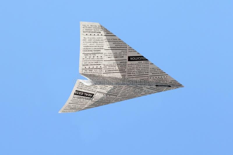 Het Vliegtuig van de krant stock foto's