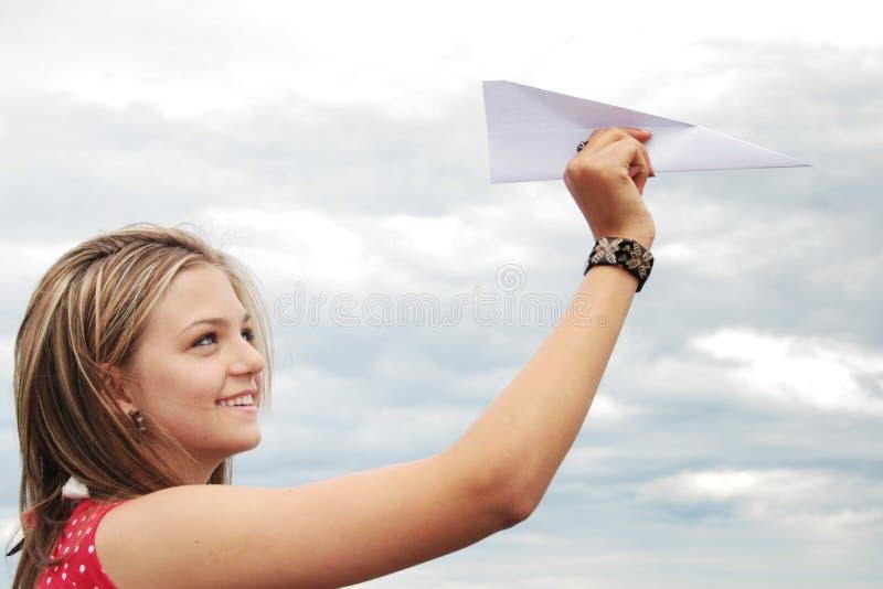 Het vliegtuig van de tiener en document royalty-vrije stock afbeelding