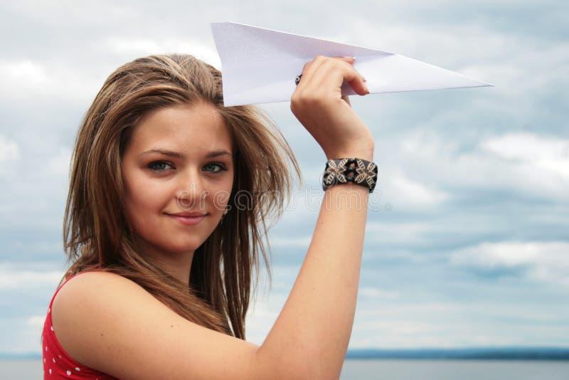Het vliegtuig van de tiener en document stock afbeelding