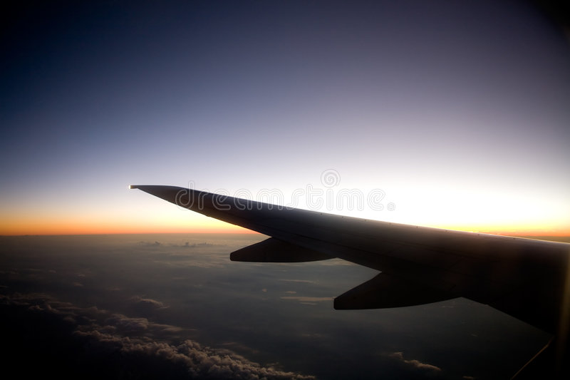 Het Vliegtuig van de zonsondergang royalty-vrije stock foto