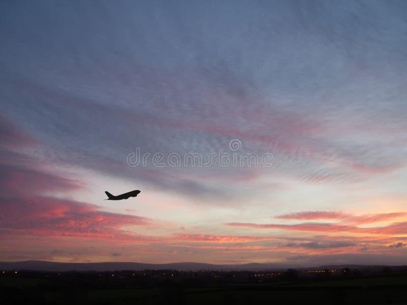 Het Vliegtuig van de zonsopgang stock afbeeldingen
