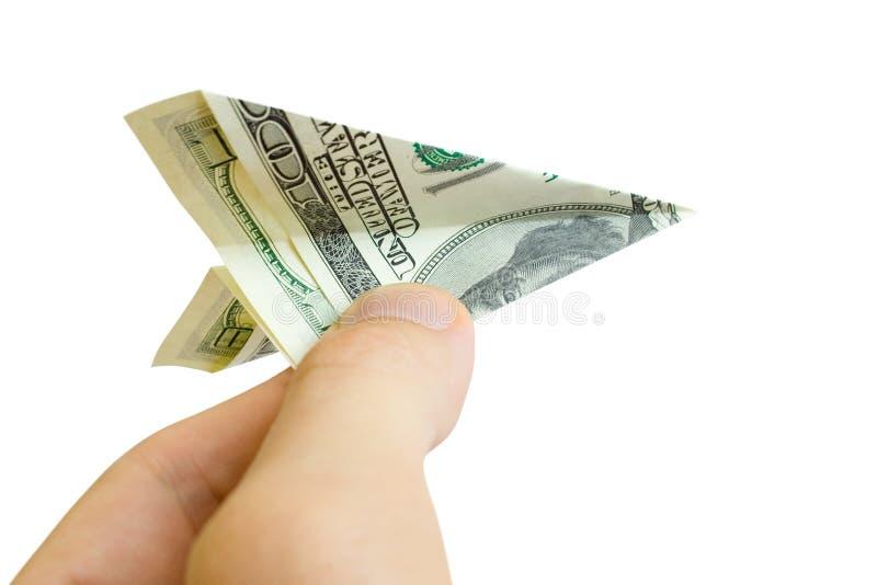 Het vliegtuig van het geld in vingers stock afbeeldingen