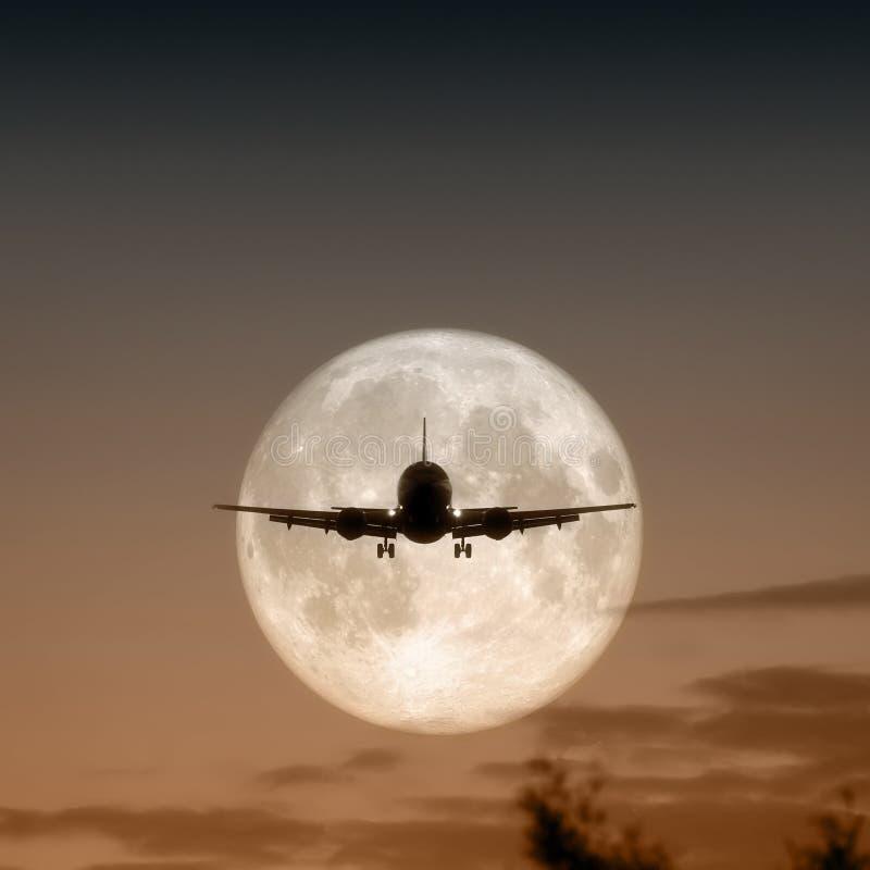 Het vliegtuigvolle maan van de lucht royalty-vrije stock afbeelding