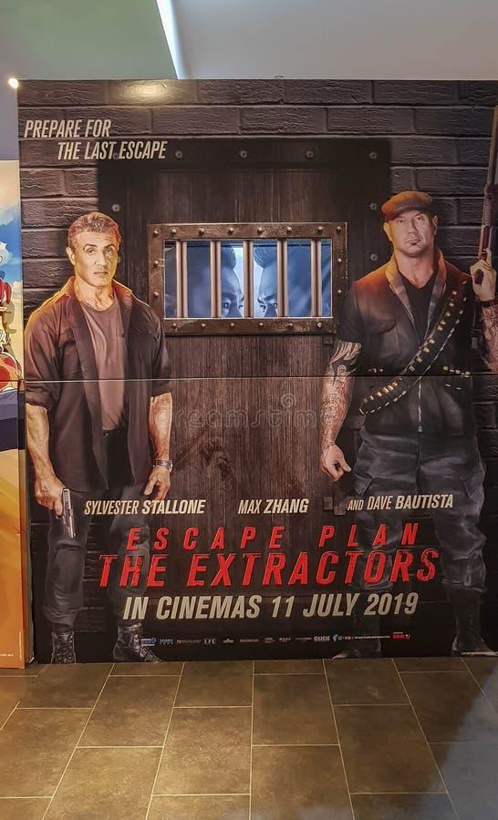 Het vluchtplan de affiche van de Trekkersfilm, is eigenschappen Sylvester Stallone, Dave Bautista van een de Amerikaanse de thril royalty-vrije stock foto's