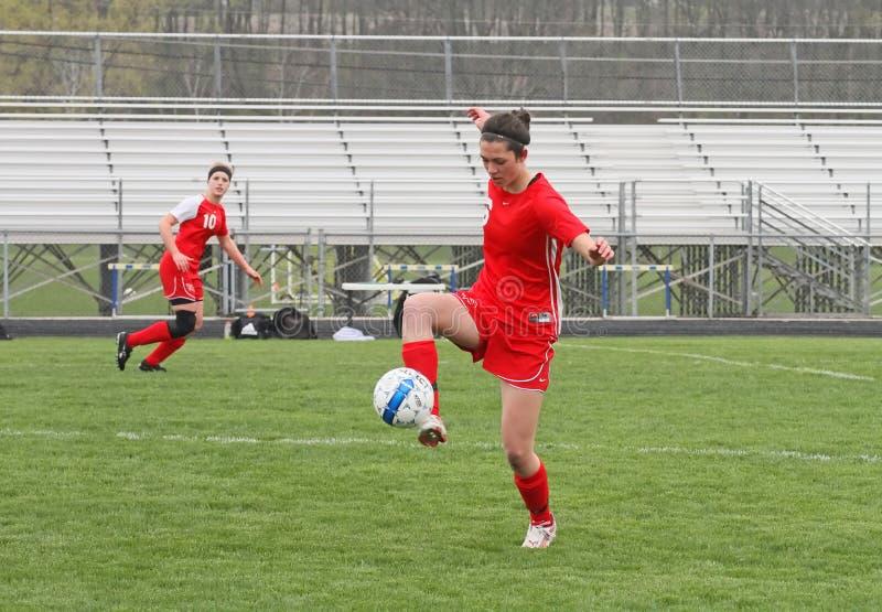 Het Voetbal van Womanâs stock foto