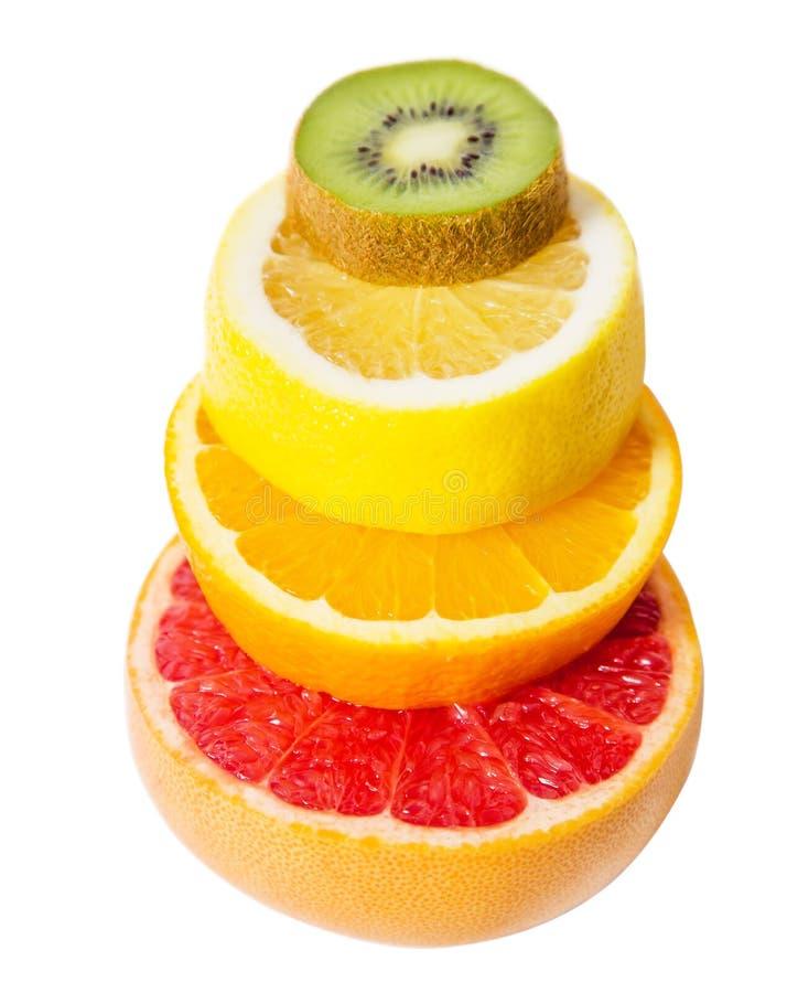 Het voetstuk van het vruchten dalende fruit, grapefruit, kiwi, citroen stock afbeeldingen