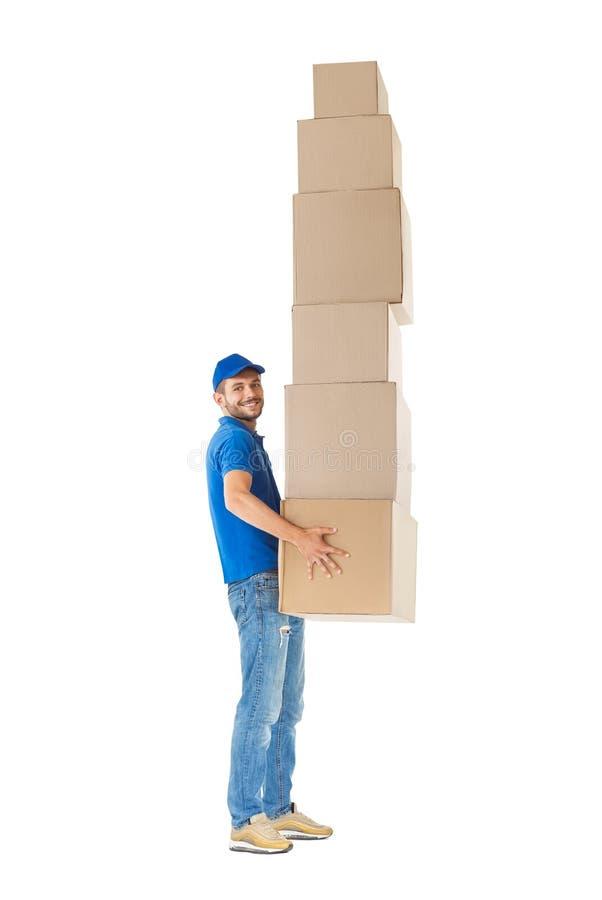 Het volledige portret van het lengteprofiel van koeriers dragende stapel dozen stock afbeeldingen