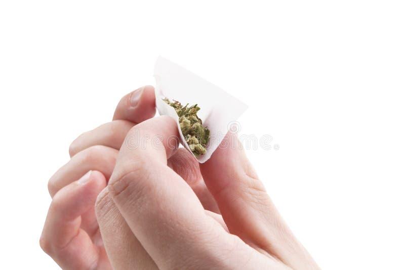 Het voorbereiden van een cannabisverbinding stock foto's
