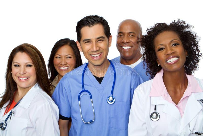 Het vriendschappelijke Spaanse verpleegster of artsen glimlachen royalty-vrije stock fotografie