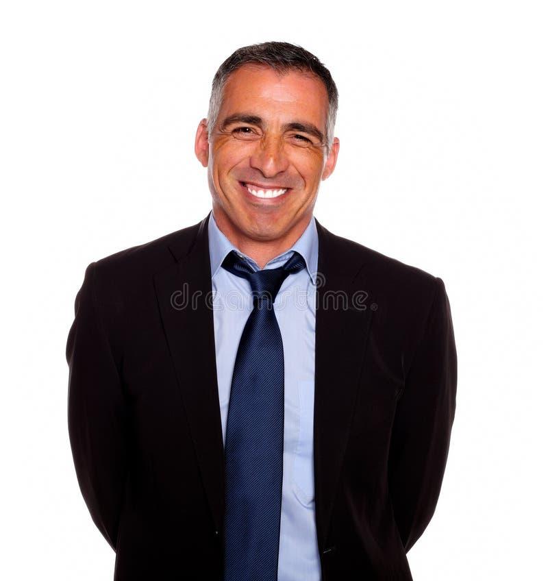 Het vriendschappelijke Spaanse zakenman glimlachen stock afbeeldingen