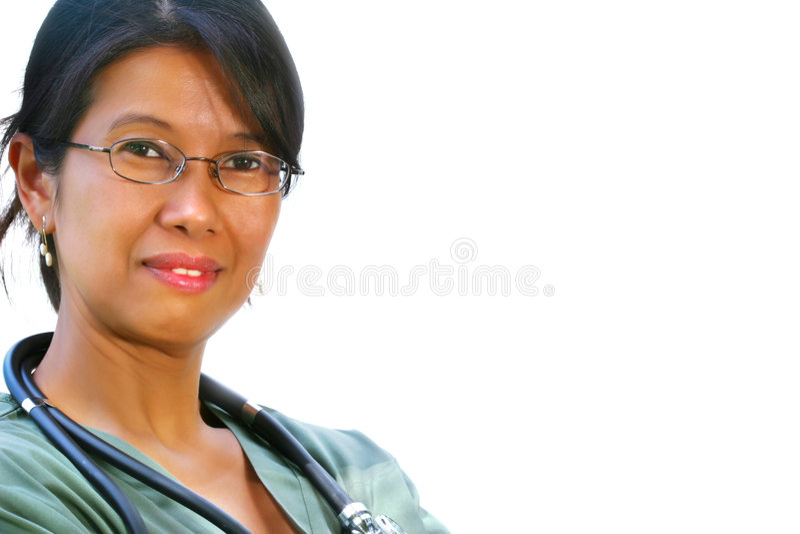 Het vriendschappelijke verpleegster glimlachen stock foto's