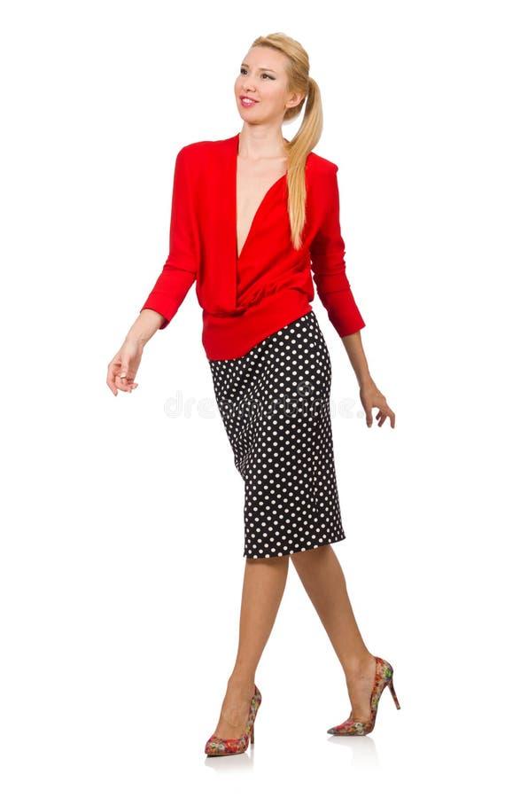 Het vrij blonde meisje die rode die blouse dragen op wit wordt geïsoleerd royalty-vrije stock foto