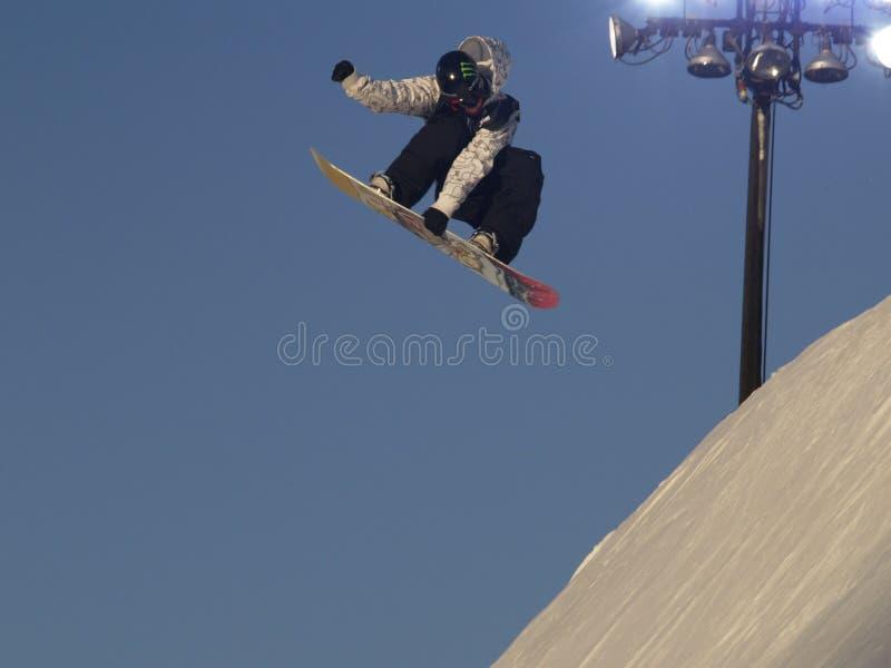 Het vrije vliegen snowboarder stock foto's
