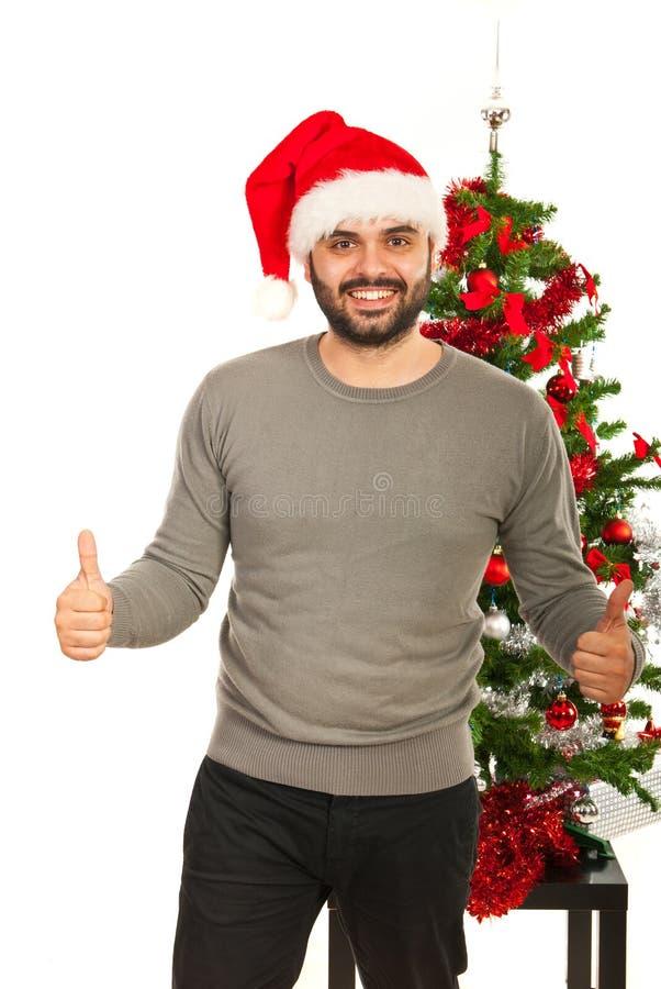 Het vrolijke Kerstmismens geven beduimelt omhoog royalty-vrije stock fotografie