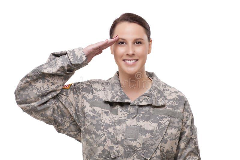Het vrouwelijke Amerikaanse militair groeten stock afbeeldingen