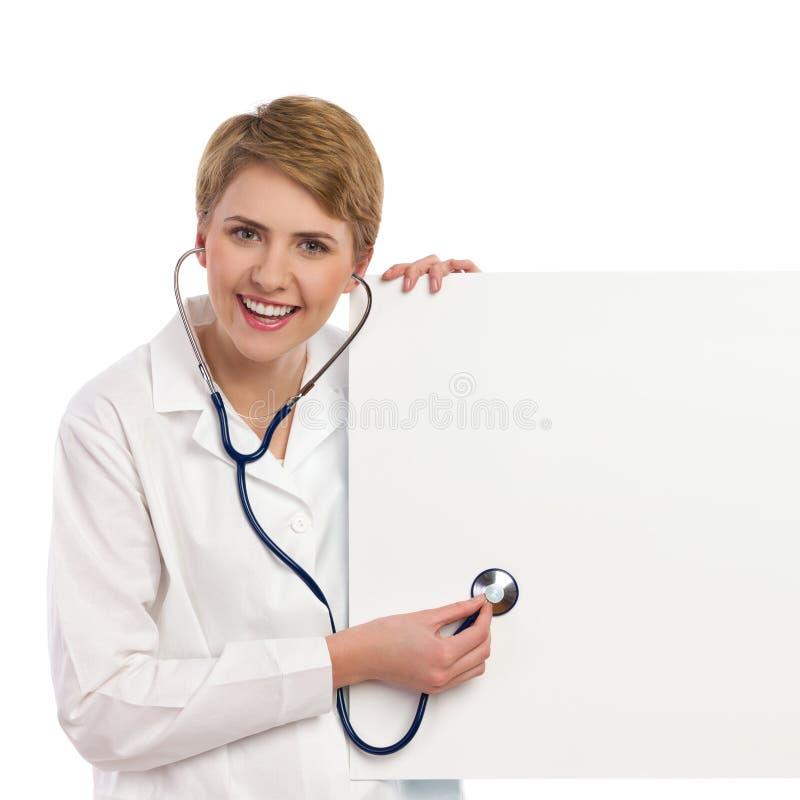Het vrouwelijke arts onderzoeken. royalty-vrije stock afbeelding