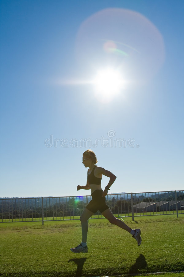 Het vrouwelijke atleet lopen. royalty-vrije stock foto