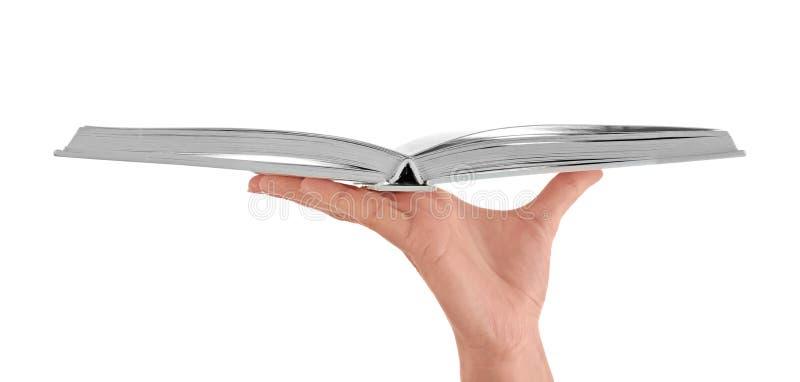 Het vrouwelijke boek van de handholding op witte achtergrond royalty-vrije stock foto's