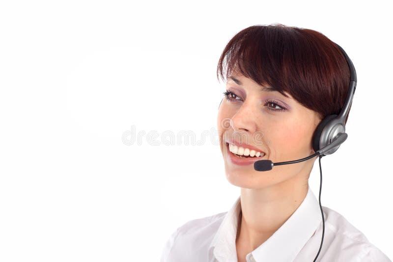 Het vrouwelijke de vertegenwoordiger van de klantendienst glimlachen stock afbeelding