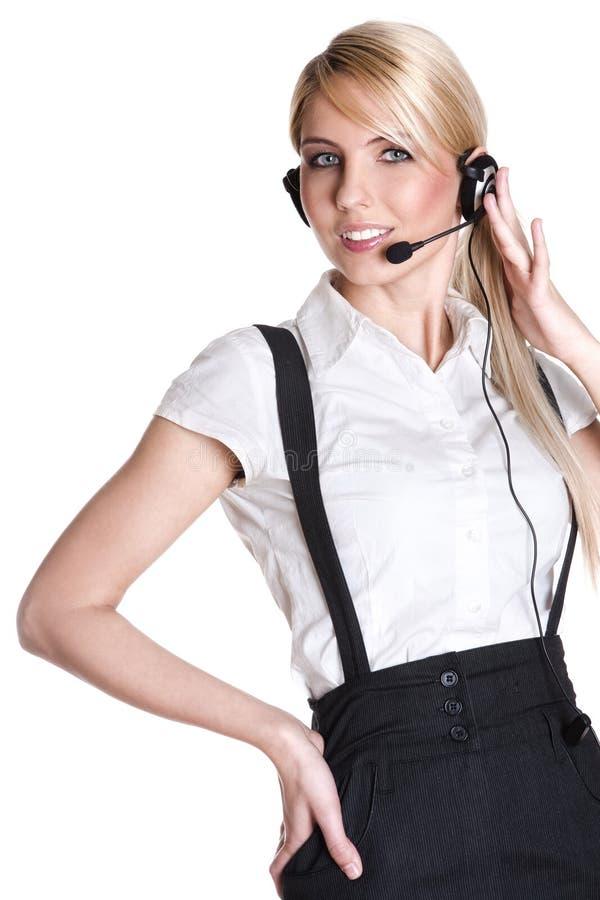 Het vrouwelijke de vertegenwoordiger van de klantendienst glimlachen stock fotografie