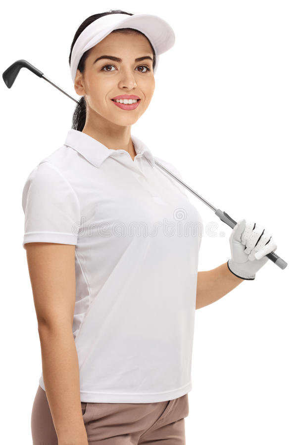 Het vrouwelijke golfspeler stellen met een golfclub stock afbeelding