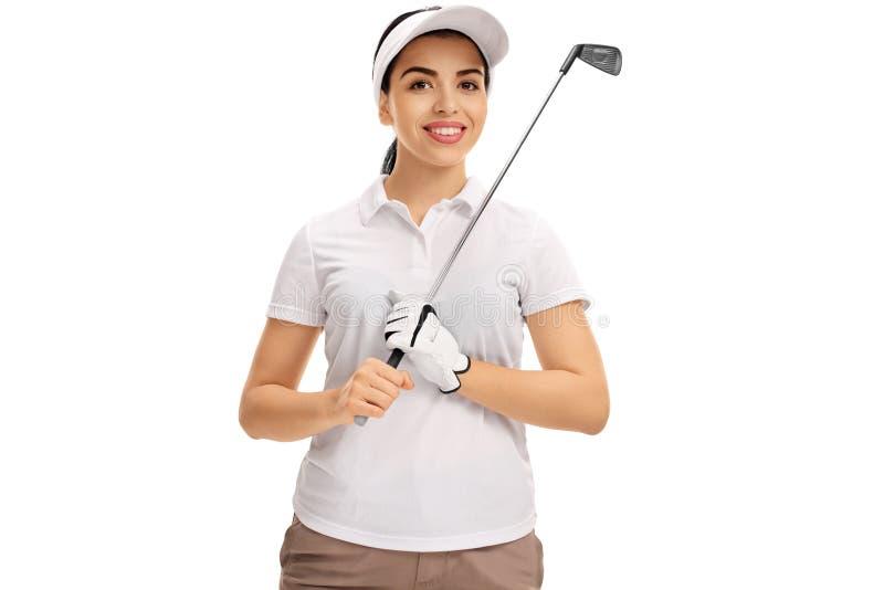 Het vrouwelijke golfspeler stellen met golfclub royalty-vrije stock afbeelding