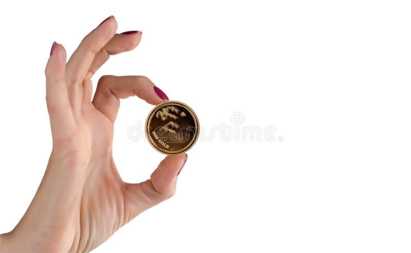 Het vrouwelijke gouden muntstuk van de handholding met het inschrijvingsgoud royalty-vrije stock foto