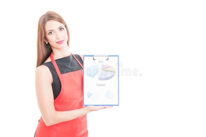 Het vrouwelijke klembord van de entepreneurholding met grafieken stock afbeelding
