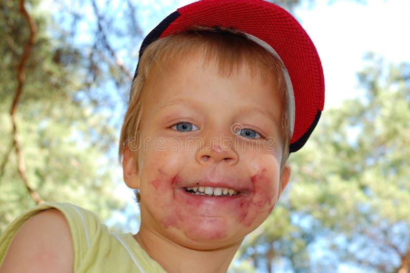 Het vuile gezicht van het kind stock fotografie
