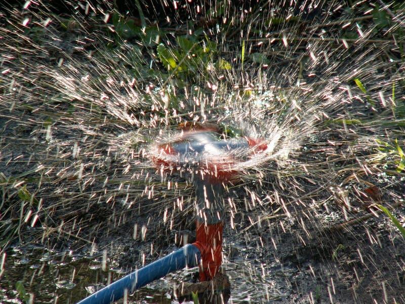 Het vuurwerk van het water stock afbeelding