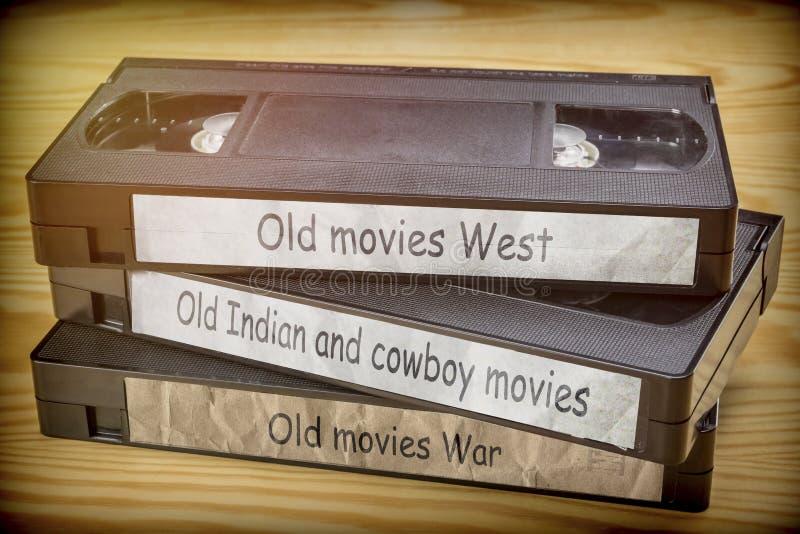 Het wat oude filmswesten, Indiër en oorlogsvideo in VHS-systeem stock afbeeldingen