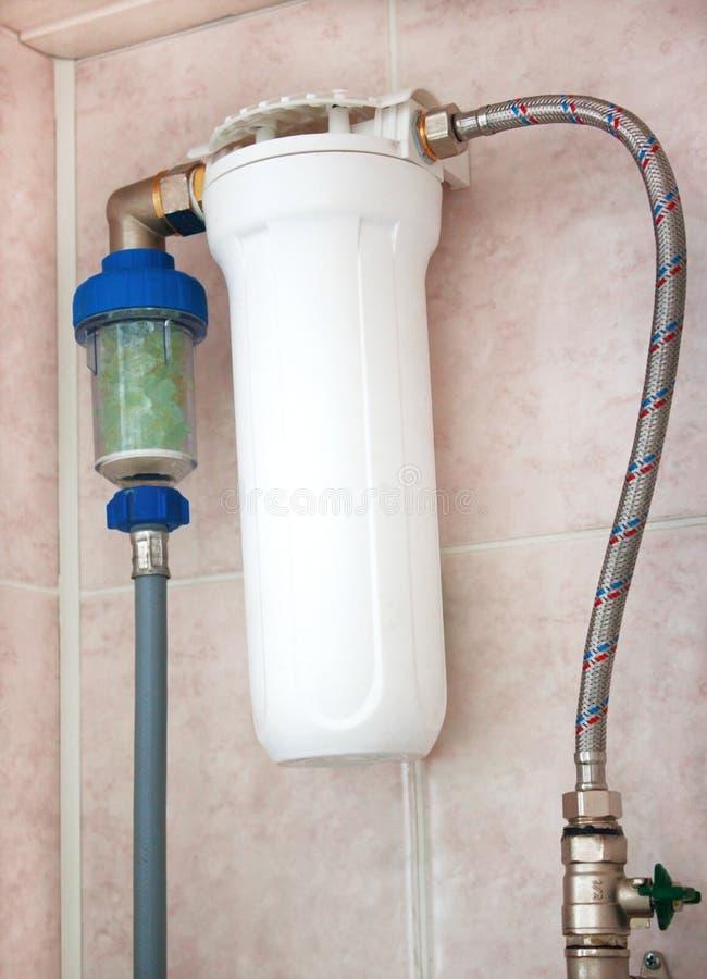 Het water in wasmachine gaat door filters royalty-vrije stock foto