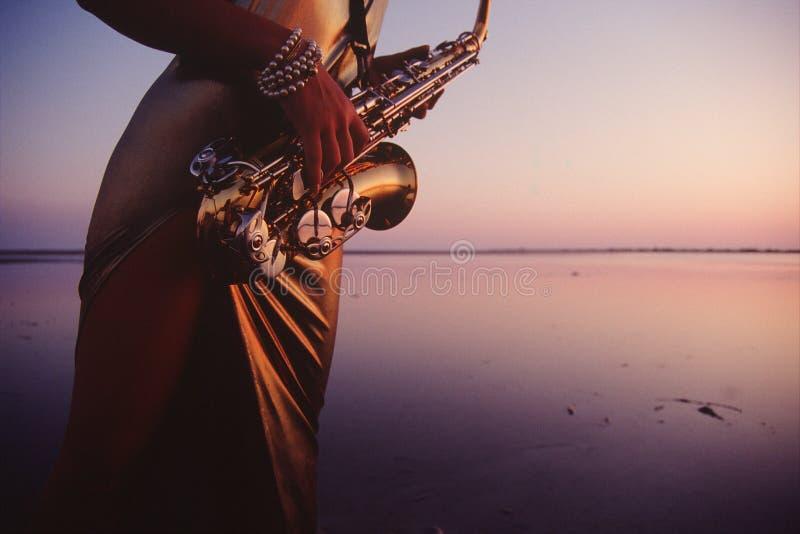 Het watermelodie van de saxofoon royalty-vrije stock foto's