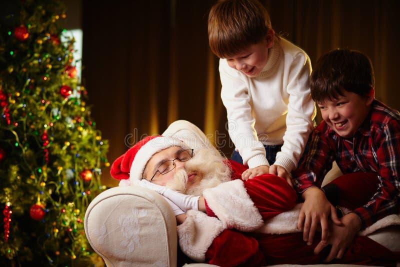 Het wekken Kerstman stock fotografie
