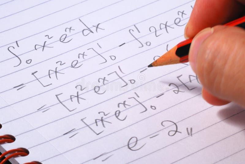 Het werk aangaande een wiskundevraag stock afbeelding
