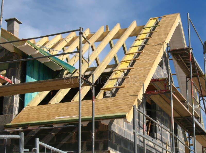 Het werk van het dakwerk bij shell stock foto