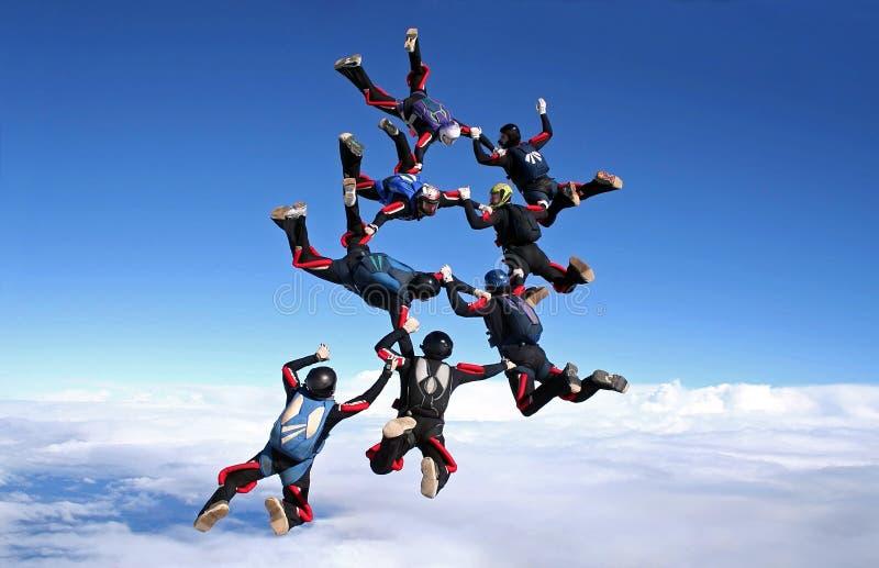 Het werk 8 van het Skydiveteam manier stock afbeelding