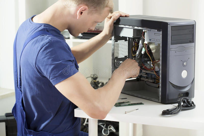 Het werken aan computer stock afbeelding