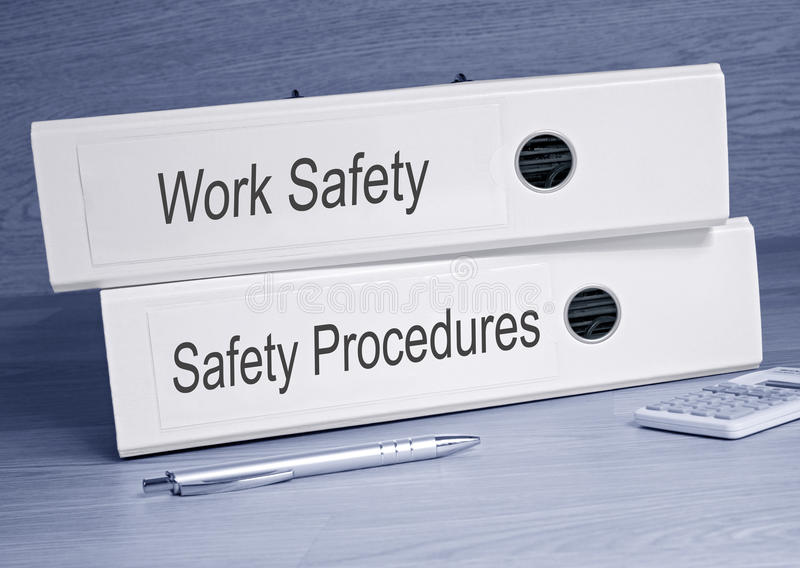 Het werkveiligheid en van Veiligheidsprocedures Bindmiddelen in het Bureau stock afbeeldingen