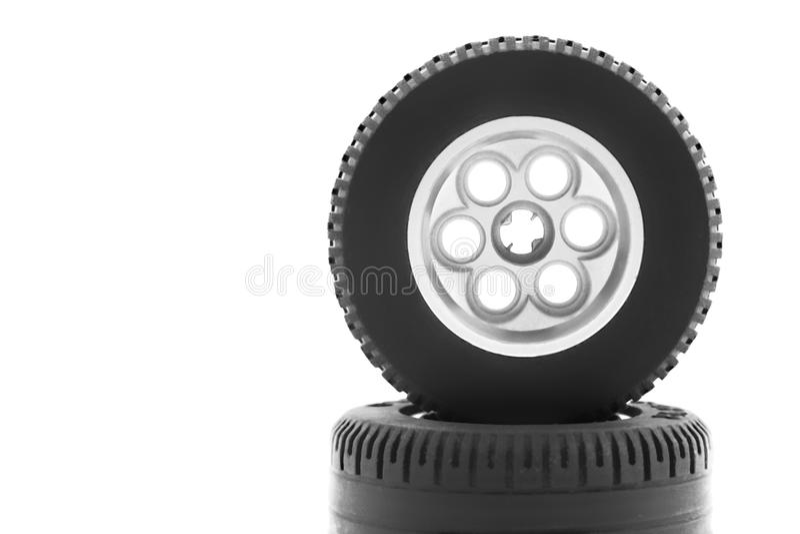 Het wiel van het stuk speelgoed op een witte achtergrond stock foto's