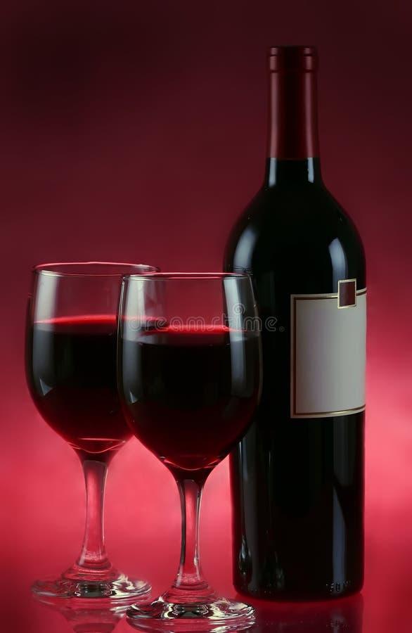 Het wijnglas en de fles van de wijn royalty-vrije stock foto