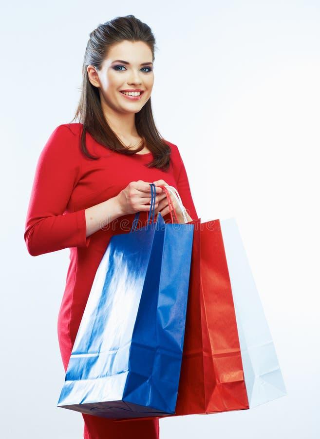 Het winkelen geïsoleerd vrouwenportret Witte achtergrond Gelukkige shopp royalty-vrije stock afbeeldingen