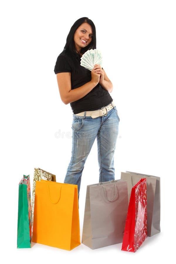 Het winkelen - Jonge vrouw met geld en zakken royalty-vrije stock fotografie