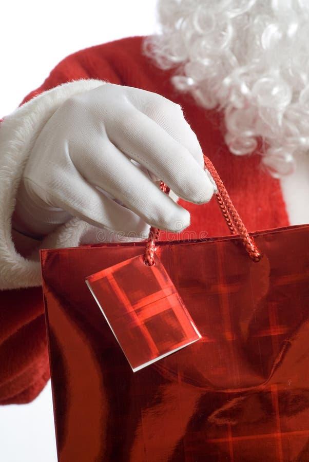Het winkelen van Kerstman zak stock foto's