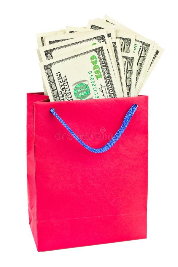 Het winkelen zak met geld royalty-vrije stock foto's