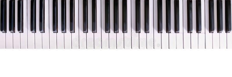 Het witte ivoor en de zwarte sleutels van een piano stock afbeeldingen