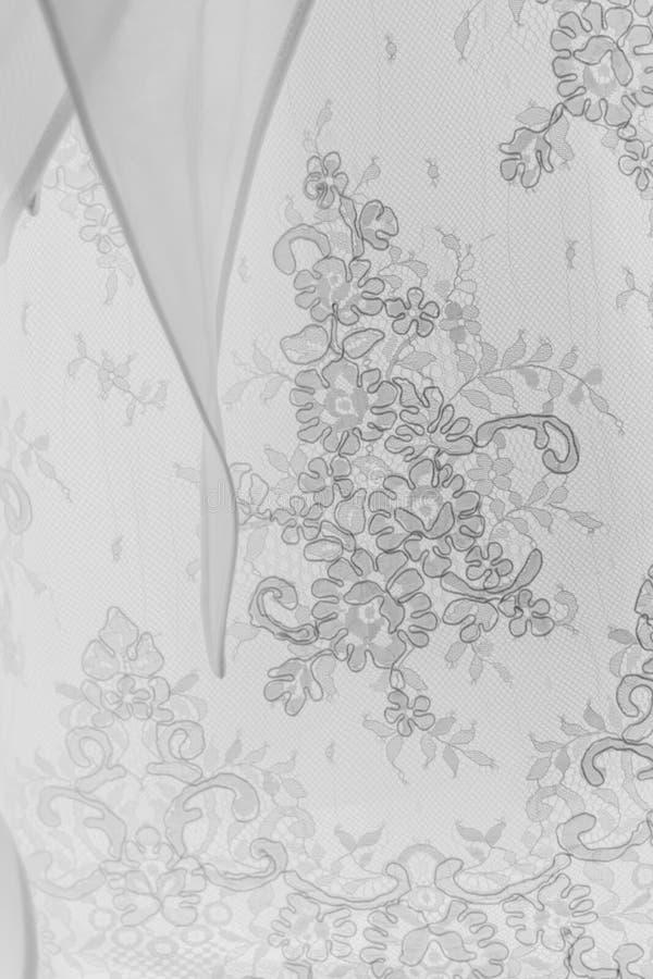 Het witte kant van de huwelijkskleding royalty-vrije stock afbeeldingen
