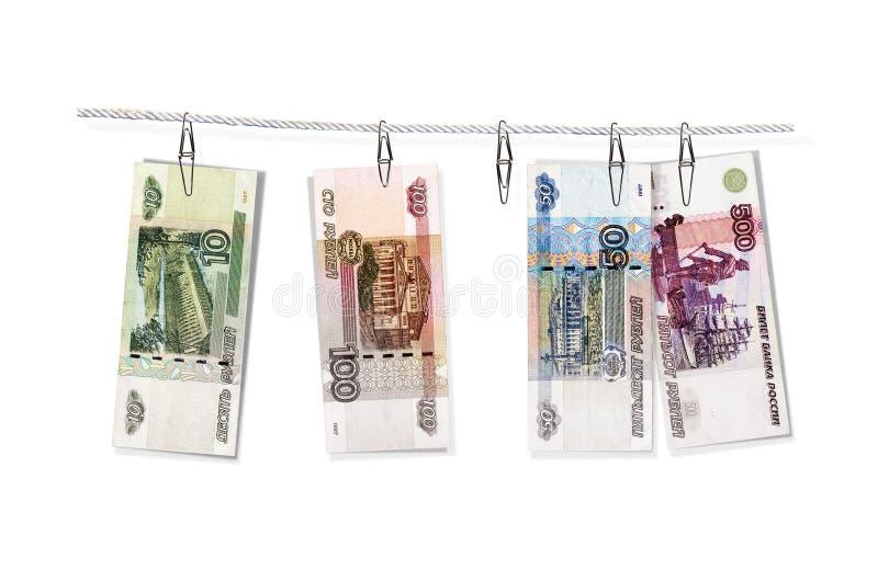 Het witwassen van Geld Grijze inkomens De bankbiljetten van de Bank van 1997 van Rusland hangen op paperclippen Geïsoleerd op wit stock illustratie