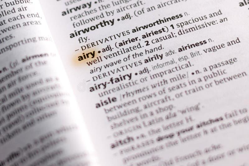 Het woord of de uitdrukking Luchtig in een woordenboek stock fotografie